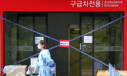 A medical worker walks past a hospital in Seoul where patients with Mers are being treated.