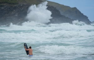 Newquay, England: Bodyboarders brave the waves in rough seas at Fistral beach as Storm Evert approaches