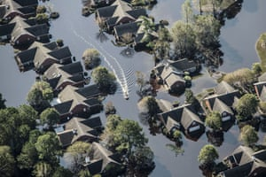 A boat passes through a flooded neighborhood in this aerial photograph taken above Wallace, North Carolina.