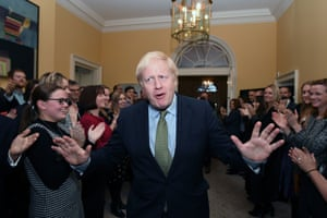 Prime Minister Boris Johnson is greeted by staff as he arrives back at 10 Downing Street, London, after meeting Queen Elizabeth II and accepting her invitation to form a new government