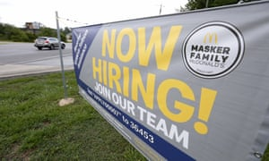 In this 21 June 2019, file photo a now hiring sign is displayed to attract potential workers at a McDonald's restaurant in Moss Point, Mississippi.