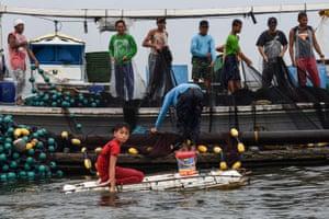 Cavesirano arrives at a fishing boat anchored at the mouth of Manila Bay