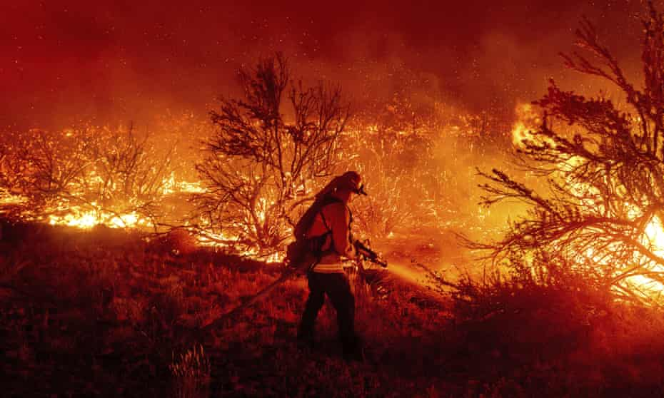 A firefighter battles the Dixie fire in California, which was exacerbated by arson. Most wildfires though, are not set by arsonists.