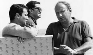 Martin Ransohoff, right, on the set of the 1967 film Don't Make Waves, discussing a scene with the actor Tony Curtis, left, and his co-producer John Calley.