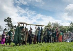 The Greenmen of Glastonbury carry the maypole