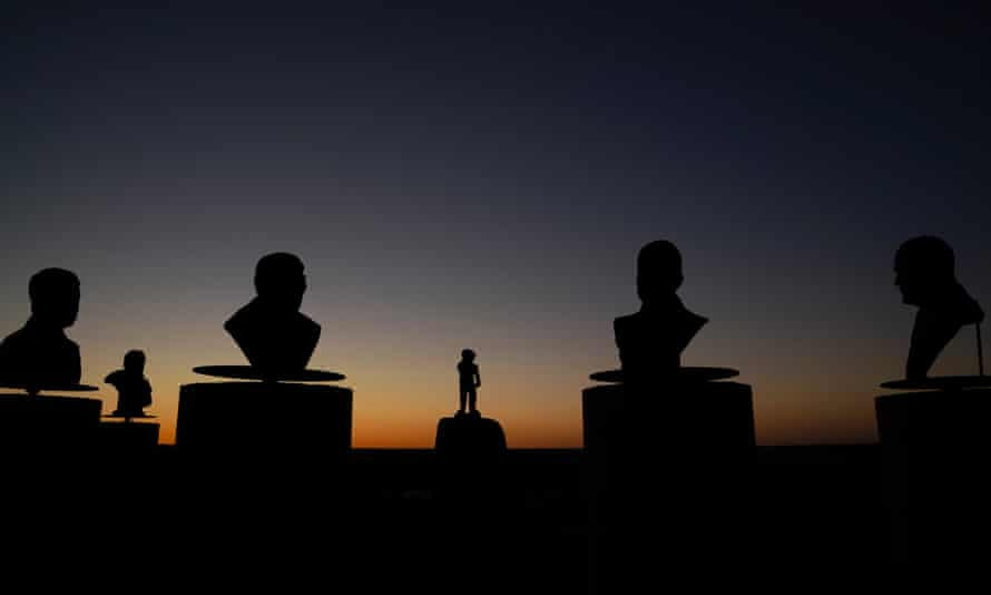 Monument Hill in Orania. Busts of former presidents of the town surround the statue of town mascot De Kleine Reus (The Little Giant), a young boy rolling up his sleeves