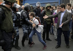 A young girl reacts after her friend was detained by police during a Moscow protest