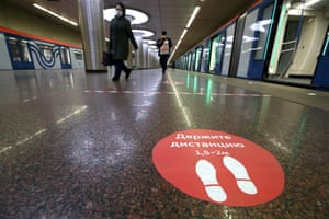 A sign on the platform at the Kotelniki station on the Moscow Metro reminds passengers about social distancing guidelines