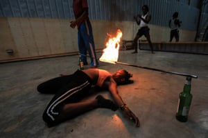 A performer practises a stunt with fire
