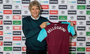Manuel Pellegrini poses with a West Ham shirt.