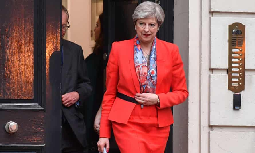 Theresa May leaves Conservative party HQ in central London on Friday morning
