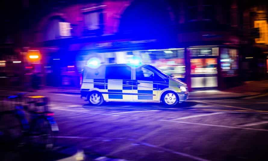 Emergency service ambulance with blue lights flashing