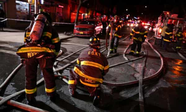 FDNY personnel work on the scene of an apartment fire in Bronx.