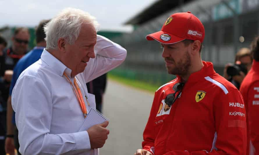 Charlie Whiting talks to the Ferrari driver Sebastian Vettel during preparations for Sunday's Melbourne Grand Prix.