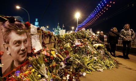 Flowers are laid at the site where Boris Nemtsov was killed in central Moscow in 2015.