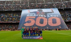 Barcelona fans celebrate Lionel Messi's 500 goals for the club before the game against Osasuna in April. He went on to score two goals that night in a 7-1 rout.