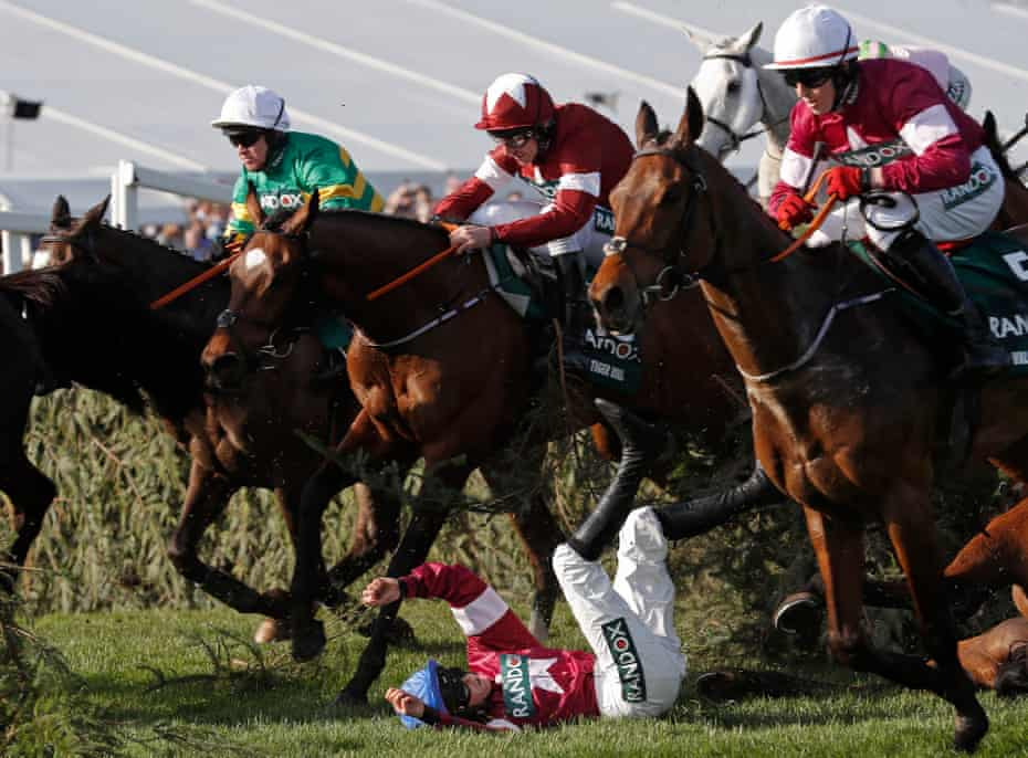 Rachael Blackmore falls off Alpha Des Obeaux at the Chair fence, just in front of eventual winner Tiger Roll, during the 2018 Grand National.