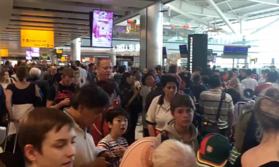 Passengers queuing at Heathrow Terminal 5, as BA cancelled flights after its IT meltdown.