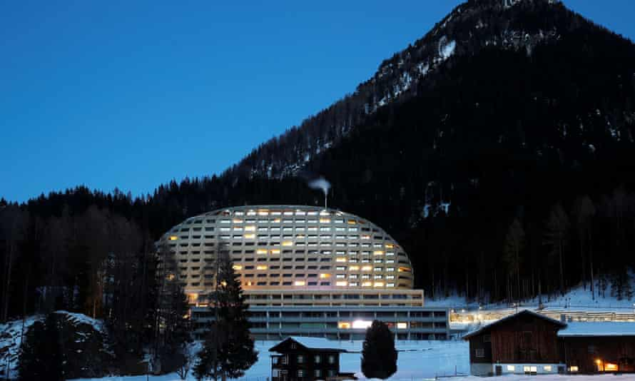 The Intercontinental Hotel is seen behind a farm house in Davos, Switzerland January 13, 2020. REUTERS/Arnd Wiegmann