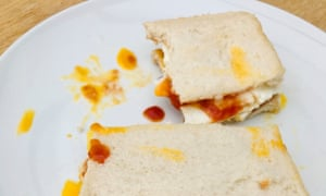 Fried egg sandwich with tomato ketchup.