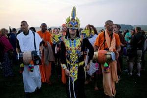 Hare Krishna singers and a costumed reveller