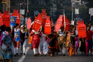 India: In Kolkata women carried a cutout of gas cylinders with slogans written on them during the women's day march, to protest against rise of petrol and cooking gas prices