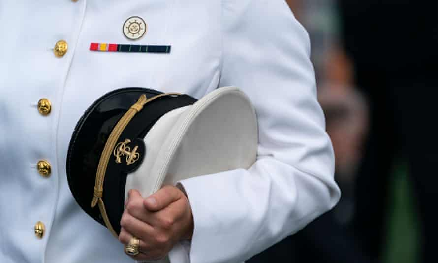 An unidentified midshipman holds his US Capitol during the United States naval academy class of 2021 graduation in Annapolis, Maryland, on 28 May.