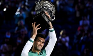 Novak Djokovic lifts the trophy after beating Daniil Medvedev in straight sets.
