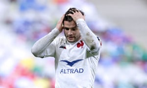 France's Brice Dulin holds his head in despair at the final whistle.