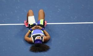 Naomi Osaka lays down in celebration.