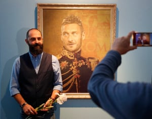 Fabrizio Birimbelli, the artist who painted the portraits, poses in front of his depiction of Francesco Totti