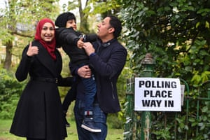 Scottish Labour party leader Anas Sarwar arrives with his wife, Furheen, at a polling station in Glasgow.