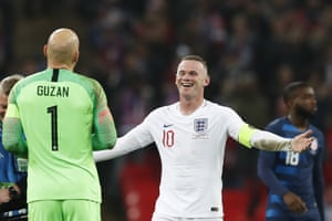 Wayne Rooney shares a joke with Brad Guzan who denied him a last goal for England.