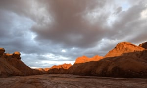 The sun's rays peak out over a future space base in north-west China's Qinghai province.