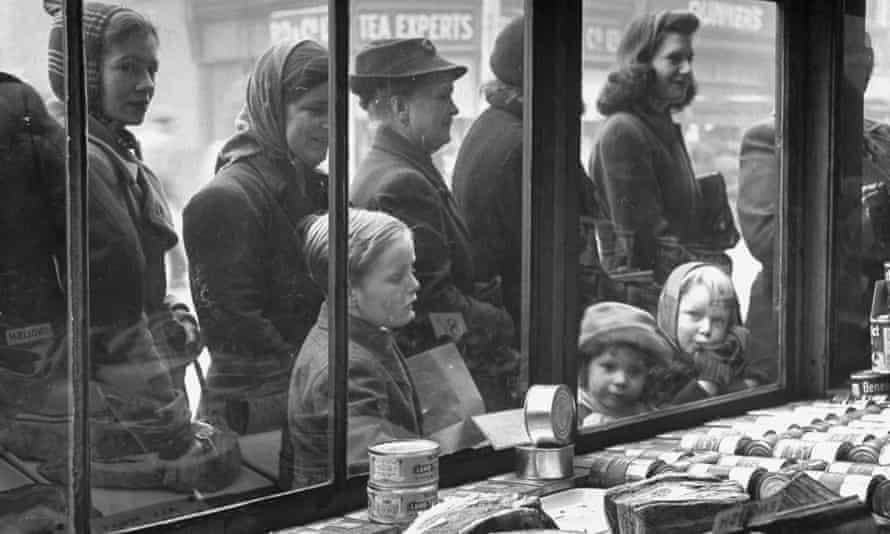 Londoners queue outside a butcher's shop in 1947.