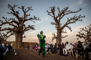 A model wears a creation by Senegalese designer Adama Paris during an outdoor show just outside Dakar.