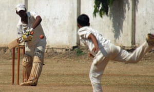 Barriers and boundaries … Indian schoolboys play cricket.