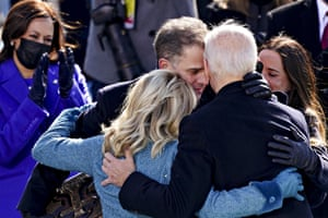 Joe Biden is embraced by his son Hunter, the first lady, Jill Biden, and daughter Ashley, during the presidential inauguration in Washington.