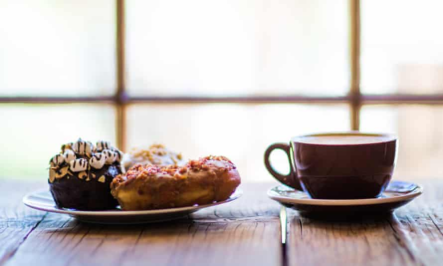 A cup of coffee and a plate of doughnuts at Short Leash Hotdogs, Phoenix, Arizona