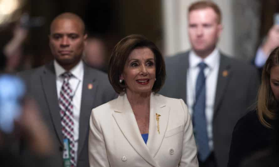 Nancy Pelosi walks to the House floor for the State of the Union address in Washington DC, on 4 February.
