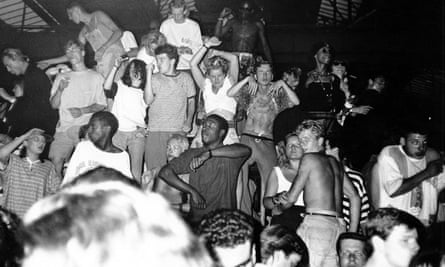People dancing at an acid house party at White Waltham airfield.