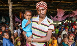 Mother and baby who lost home in PNG earthquake seek refuge in temporary shelter