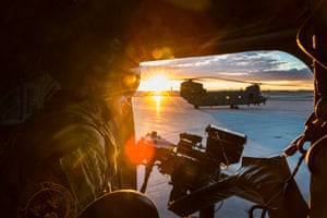 Photographer of the year, first place. Another image by Cpl Tim Laurence shows a weapon systems operator looking out of the door of his Chinook. Two Royal Air Force Chinook helicopters were deployed to Arizona, US, to take part in a training programme