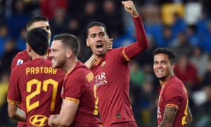 Chris Smalling celebrates with his teammates after scoring in the win over Udinese.