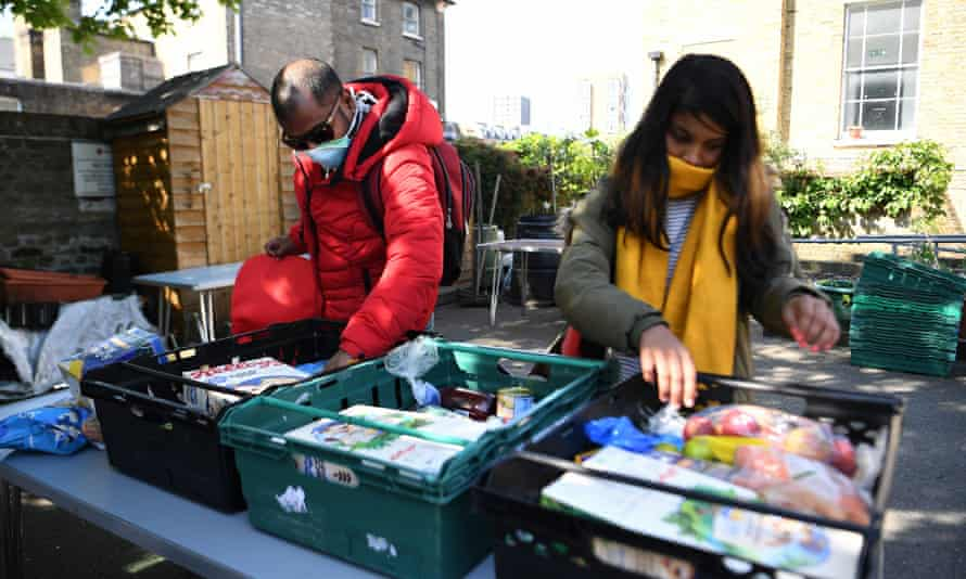 Asylum seekers receive emergency food from a Red Cross centre in Dalston, London.