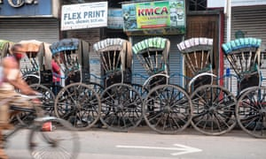 Rickshaws parked on a Kolkata roadside on the first day of India's coronavirus lockdown
