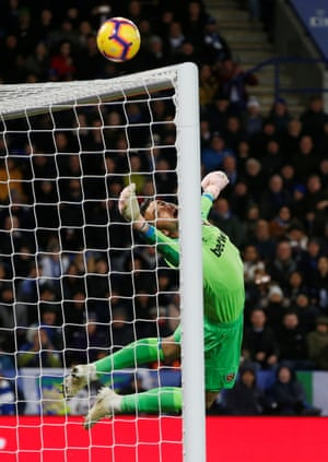 West Ham's keeper Lukasz Fabianski watches as the ball flies just over the bar from Harry Maguire's header at the King Power Stadium,. The match ended in a 1-1 draw.