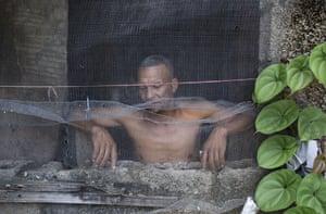 Man at window in Caracas