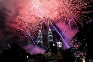 Malaysia's landmark Petronas Twin Towers framed by the firework display in Kuala Lumpur