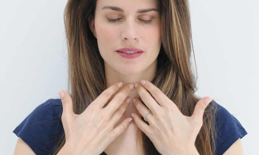 Sophrology expert Dominique Antiglio with eyes closed and fingertips touching throat
